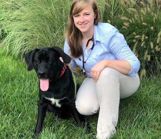 Doctor posing next to dog
